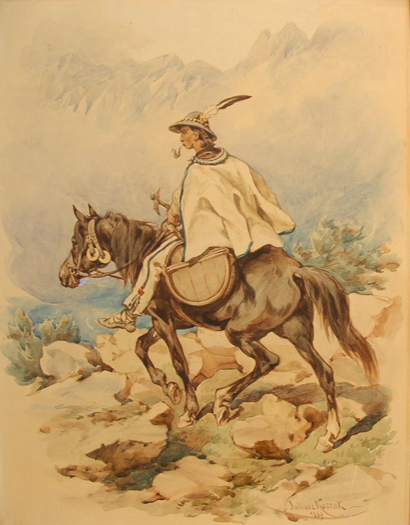 Man Riding on Horseback through the Mountains