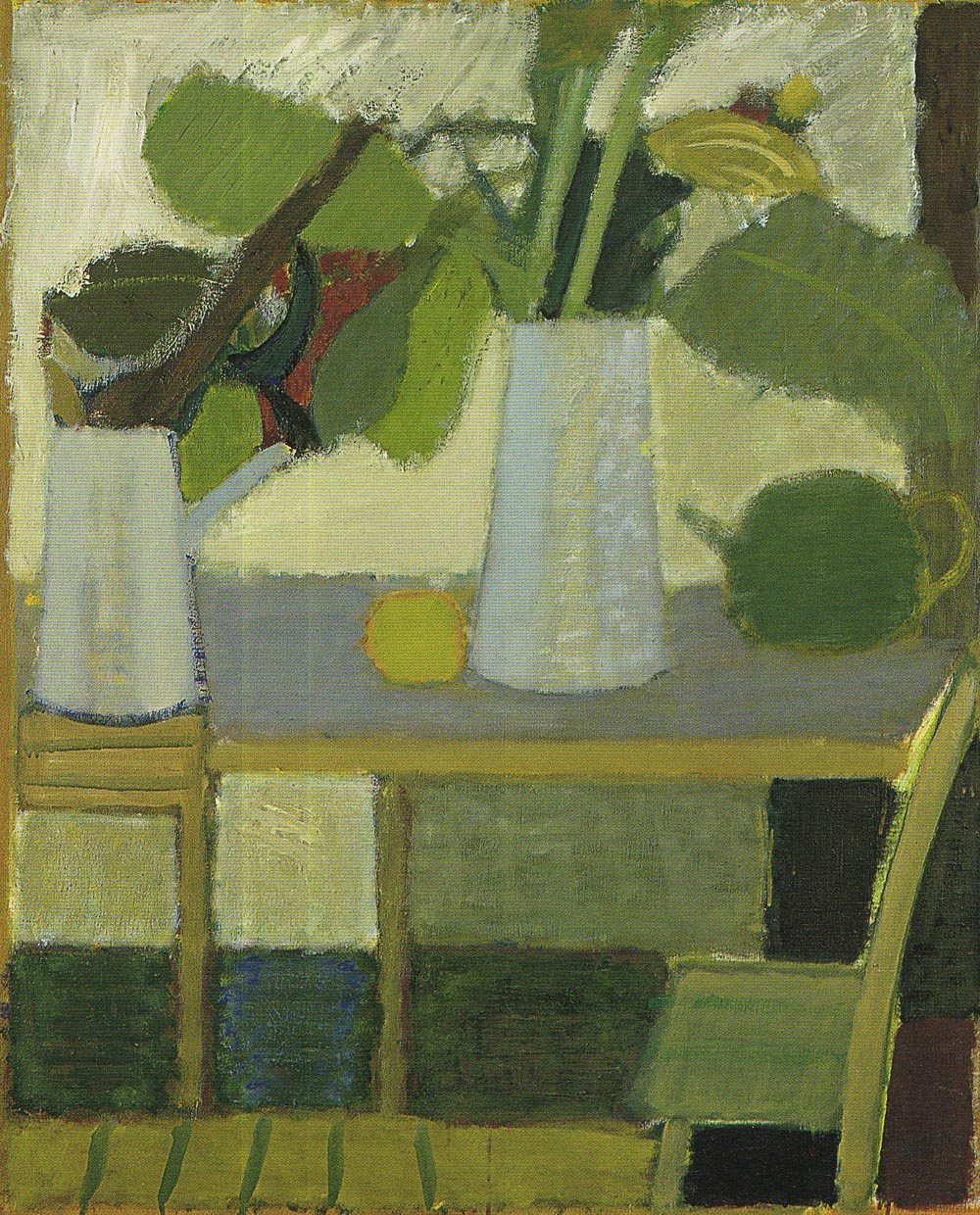 Leaves In A White Vase On A Table